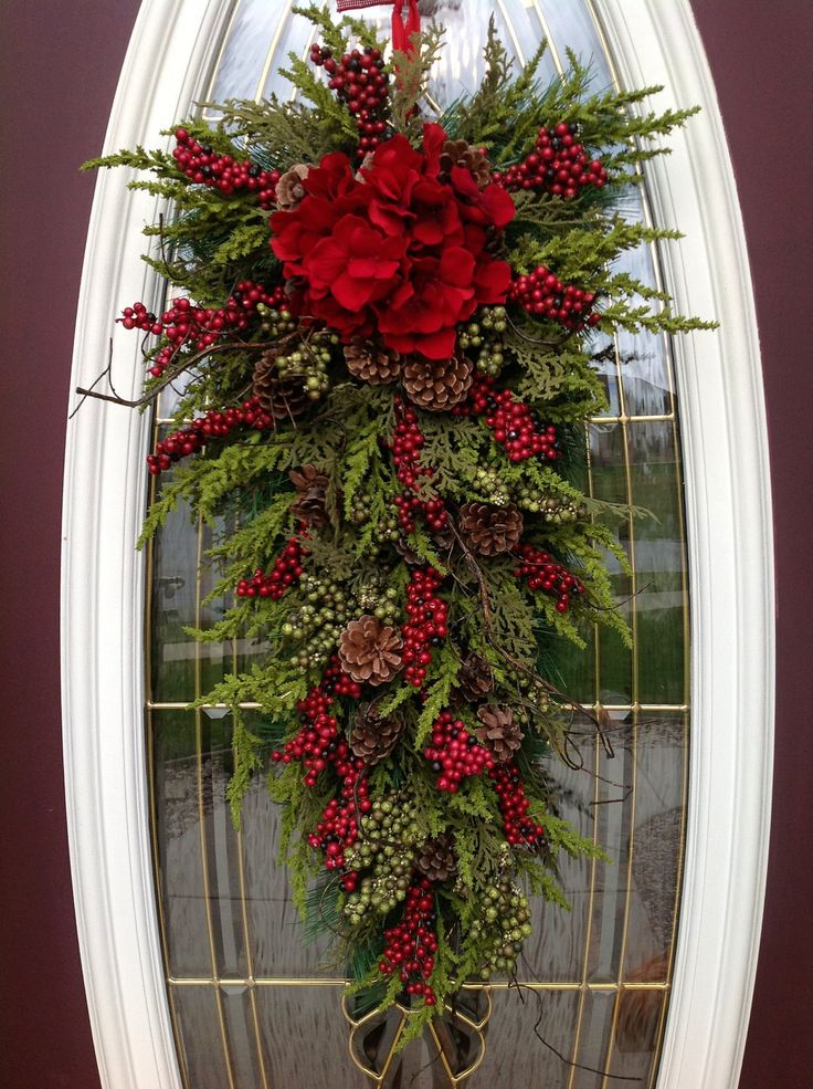 "Christmas Wreath Winter Wreath Holiday Vertical Teardrop Swag Door Decor..""Seasons Greetings"" Red w/ Green via Etsy."