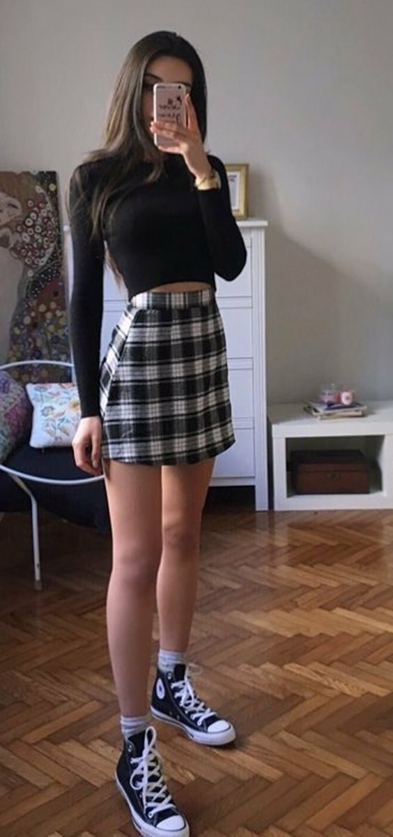 How to update the look with All Star. Black sleeve blouse, plaid miniskirt, sneakers