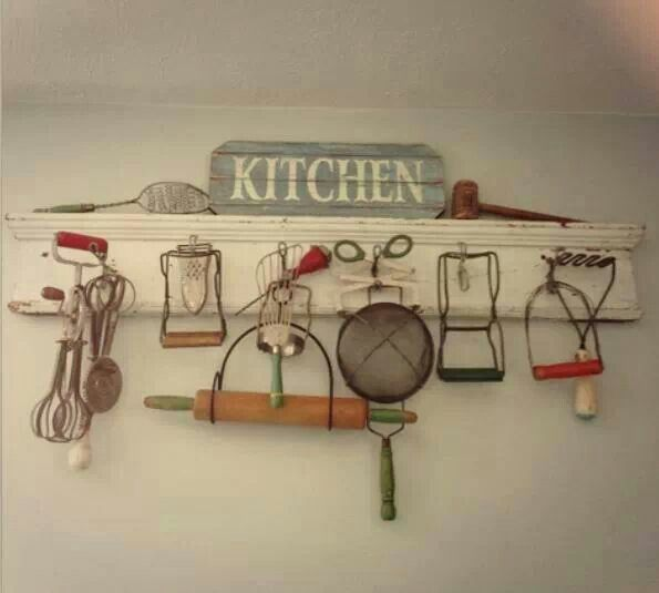 Utensils~I have some of these old utensils, what a great way to display them!!