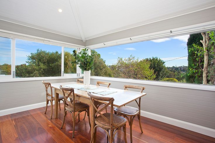 Big dining room seats 8 or more people, district views, bi fold windows, timber dining setting, vase, leafy, Pilcher Residential