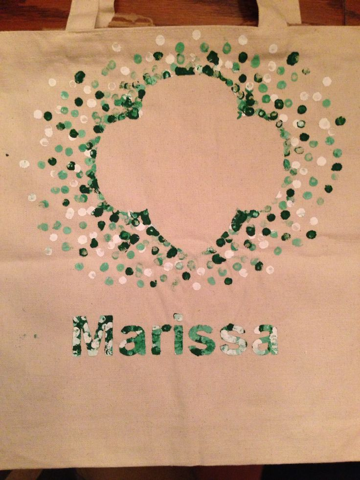 Girl Scout bags: Our girls made bags for their GS stuff (binder, sash/vest, etc.). One of the parents used a printer/cutter to cut stencils then we spray glued them on. Then the girls mixed green and white paint to get the shades they wanted. They painted on the dots using the eraser-end of a pencil.  Make sure to put cardboard inside first. Let dry overnight and carefully peel away the stencil.