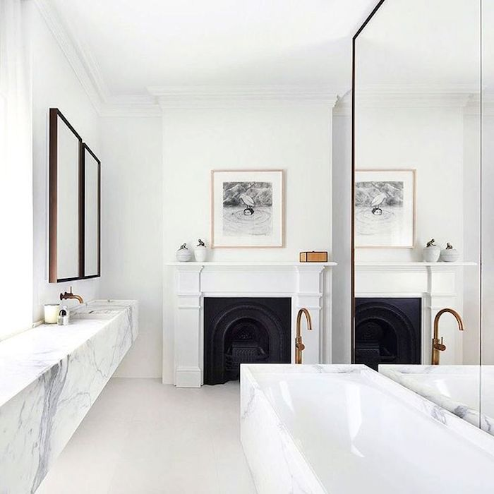 "Source: Dust JacketThis bathroom might be perfectly ""on trend"". Marble, brass, clean and minimal with a nod to the period bones of the house. The shower (rather spacious) is tucked away behind that large mirror on the right. It's similar to the look I'm trying to achieve in my own place but of course….I'm going dark……….of course I am…….."