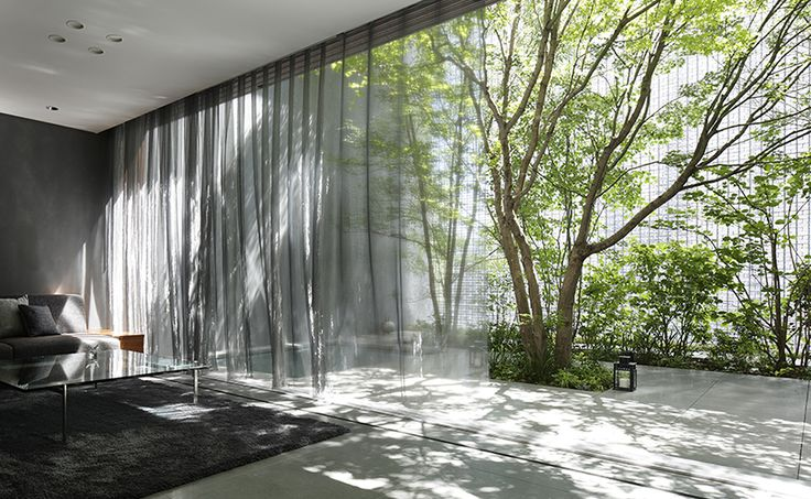 Hiroshi Nakamura and NAP created a garden and optical glass façade on the street side of the Optical Glass House, to offer privacy and tranquility. #architecture