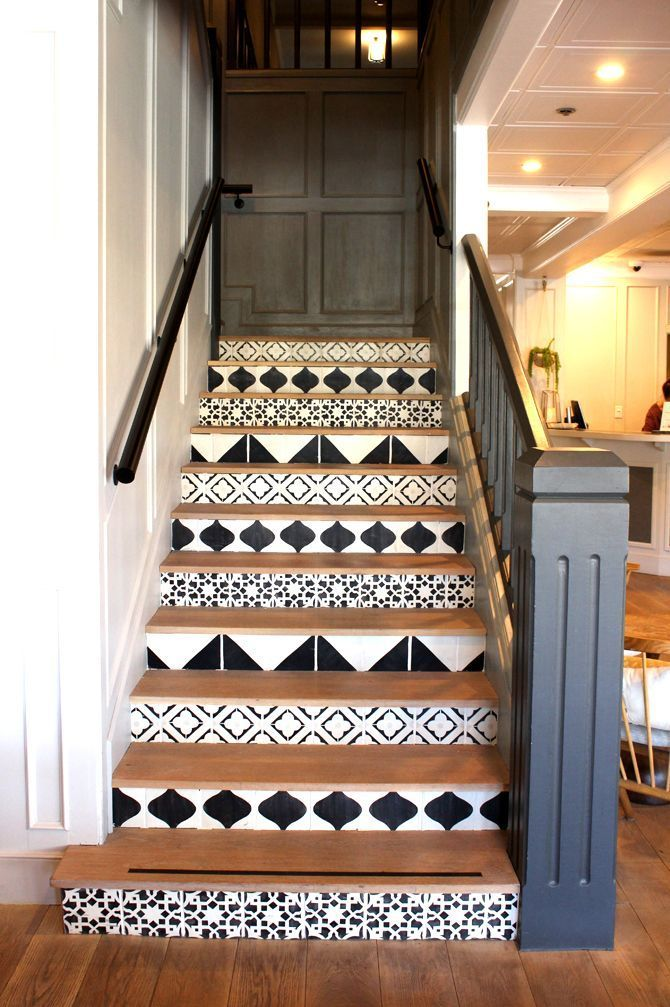 painted black and white geometric patterned stairs