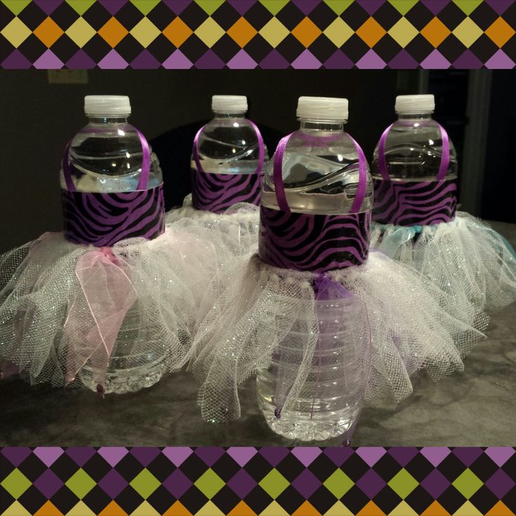 Aren't these adorable? Water bottles + Duct tape + Ribbon + Hair scrunchie…