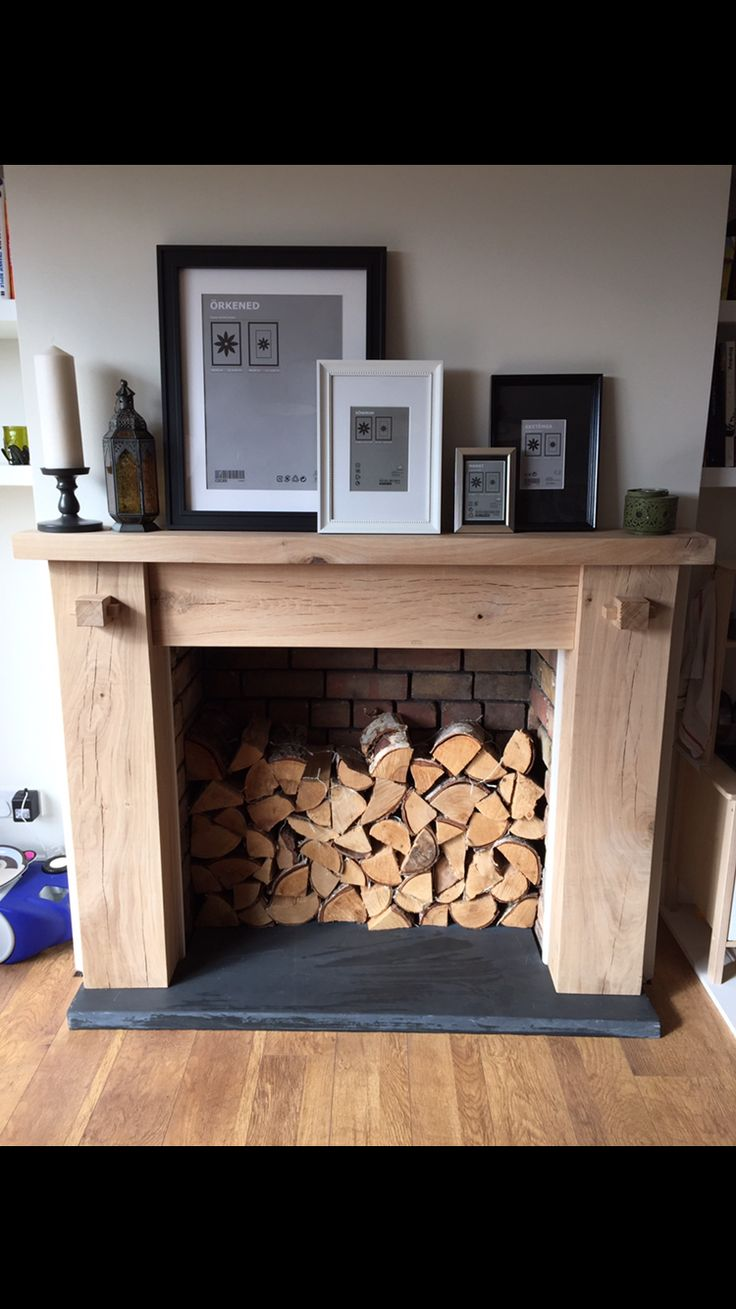 Rustic oak fire surround. Made from sleepers.