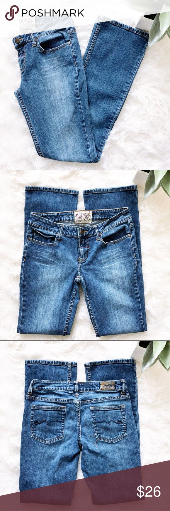"American Rag Medium Wash Bootcut Jeans Slim on the top & wider below the knee, the Bootcut look is a look that always flatters! Medium wash jeans in a Bootcut style from American Rag, gently worn, great condition! Features 1 button closure with zip fly, 5 pocket styling, & medium wash with light fading & whiskering detail. 99% cotton, 1% spandex. Waist ~30"", inseam ~30.5"", front rise ~7.5"", back rise ~12"", leg opening ~16"".  Size 5R. *Stitching on back right pocket is loose. Does not affect…"