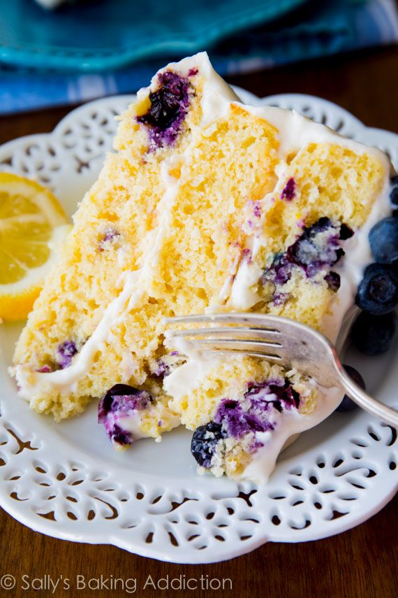 Deliciously sweet and light ~Lemon Blueberry Layer Cake. Tangy cream cheese frosting gives each bite a sweet touch