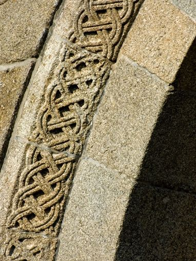 Detail of the Celtic Knots on the façade of the church of Santa Maria de Airães (XI century), Felgueiras, northern Portugal.  Image: http://www.rotadoromanico.com/vPT/GaleriaDigital/Paginas/Galeria.aspx?galeria=Fotografias&regiao&monumento&categoria=Exterior&TabNumber=3