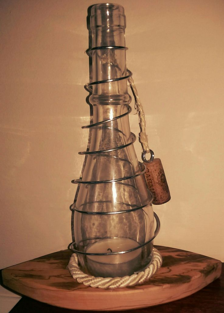 Cut wine bottle, mounted on Italian olive wood, decorated with cord and galvanised garden wire to become a tealight/candle holder