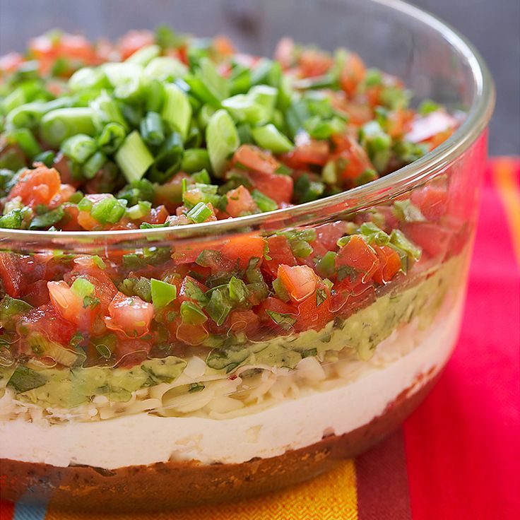 Both Southwestern flavors and a fresh ingredient list makes our Seven Layer Dip the ultimate recipe for the big game.