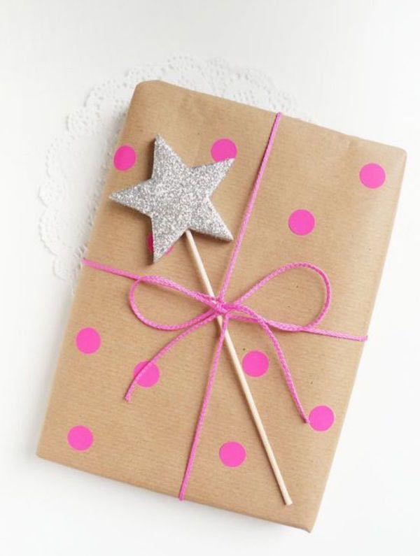Sneak in an adorable surprise with this polka dot wrapping! And... a sparkly star wand for accent?! Why not!  So much cuteness in one tiny package! #amauiweddingday #mauiweddings www.amauiweddingday.com