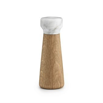 The stylish Craft salt mill is designed by Simon Legald for the Danish brand Normann Copenhagen. The mill is made of oak with a top made of solid marble and the simple shape and its weight makes it comfortable to hold. Hidden inside of Craft is a ceramic CrushGrind grinder which is one of the leading brands on the market used for mills which makes it last for a very long time.