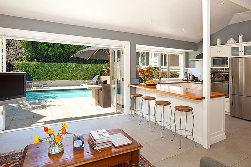 Kitchen bar that opens directly to pool backyard - so impractical for my home but oh my gosh I can dream right!?