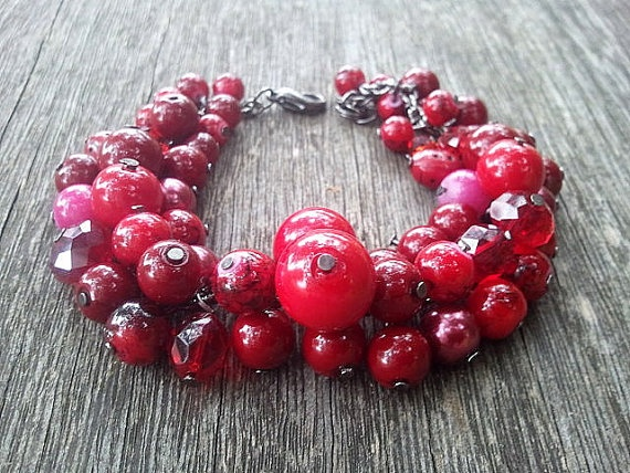 Red pinky sweet cherries on black wire by PupaDesign on Etsy, $19.00