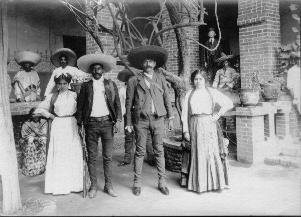 Emiliano y Eufemio Zapata con sus esposas, 1914 by Hugo Brehme