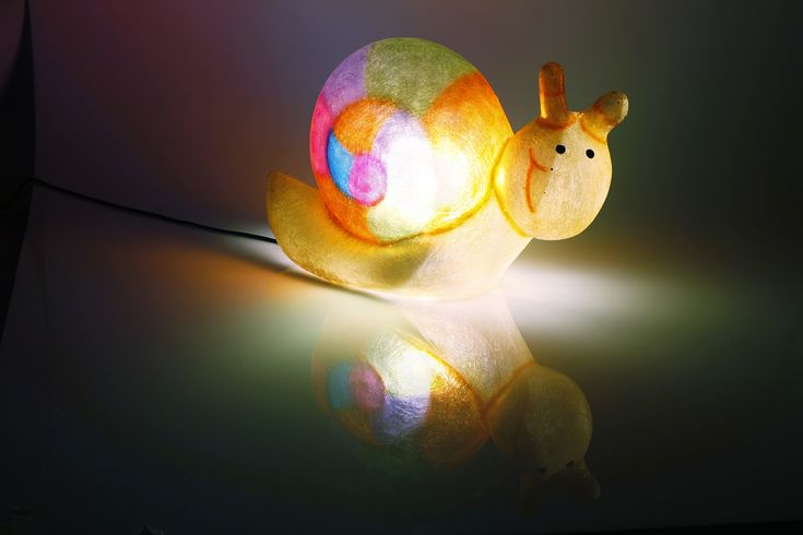 Slow the Snail - fiberglass lamp  Handmade fiberglass lamp. It can be used as a floor or desk lamp, or even as a night-light for the children's room.  Fiberglass material means it is robust and lightweight, which makes it ideal for use in the children's room. The bulb is screwed inside the lamp, so it can be placed safely on any surface; even carpeted or wooden floor.