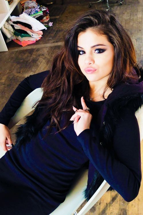 Selena gomez!! Looks like she is taking a selfie but it is SOO awesome she looks pretty in all of her pictures