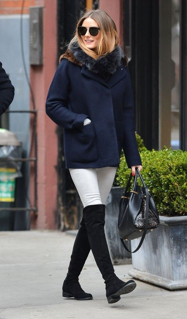 Olivia Palermo looks cozy in a fur trimmed topper and suede boots. Out in NYC