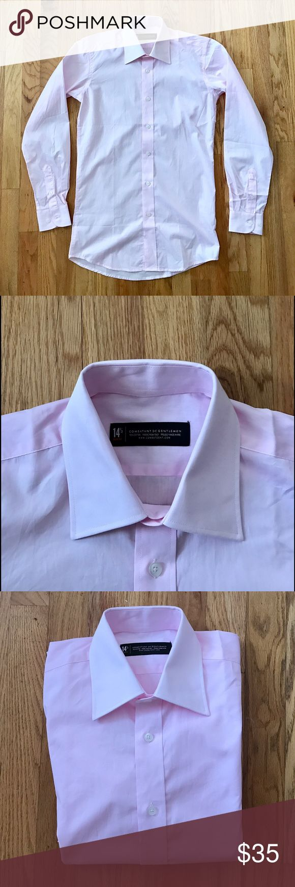 """Slim fit pink oxford shirt Light pink slim fit oxford shirt by Combatant Gentleman. My boyfriend bought this shirt and it's too small for him. Would be good for a slim guy but could definitely be worn by a woman as well! Color is most accurate in first pic. Fabric from Italy. New condition. 