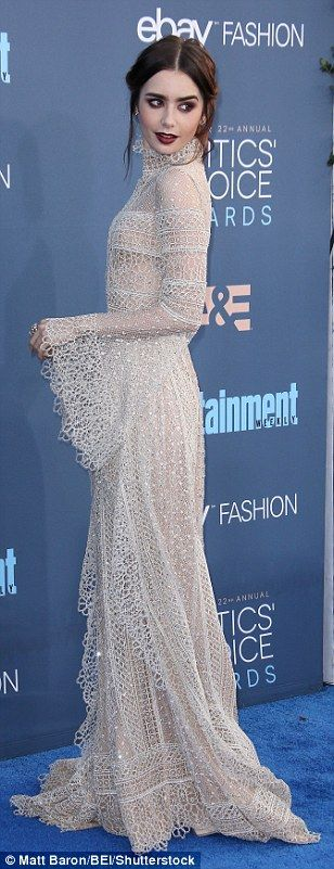 Getting it right: Lily Collins stunned in a delicate high-neck dress with gothic hair and ...
