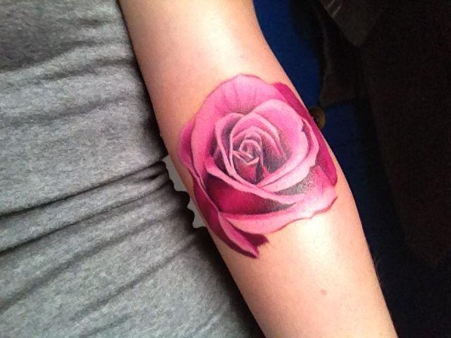 Pink rose arm tattoo