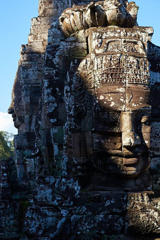 https://flic.kr/p/RjdFfJ | Buddha statue, Bayon Temple, Angkor, Cambodia 1 | Angkor Thom, Bayon temple  Those famous Buddha head statues stand at each corner of the top of Bayon temple.  At the end of October, the rainy season is not finished, Cambodia is still cloudy. Thus, visiting Angkor Wat, I could benefit from a beautifull light filtrered by clouds and humidity.  Every day, between 1h and 3h on the afternoon, heavy rain falled and I would rest on my tuk-tuk hammock. On y first day…