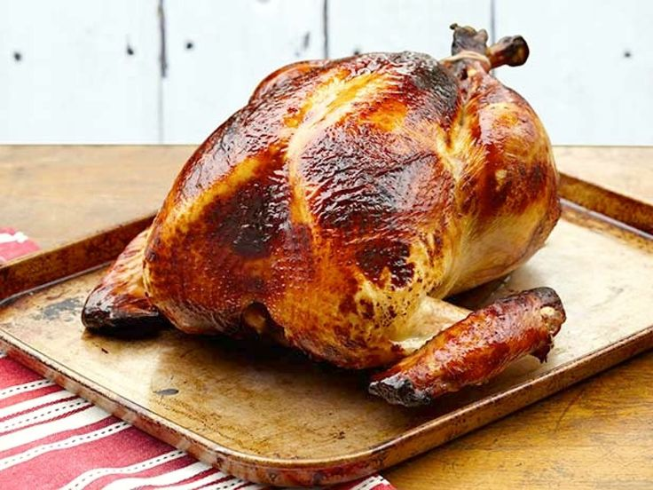 BEST EVER! Leaves oven free for sides and smells SO good! Honey Brined Smoked Turkey recipe from Alton Brown via Food Network