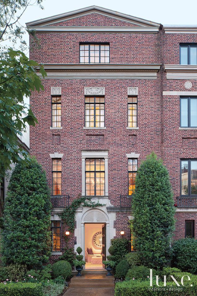 A traditional Washington home's classically balanced brick and limestone exterior.
