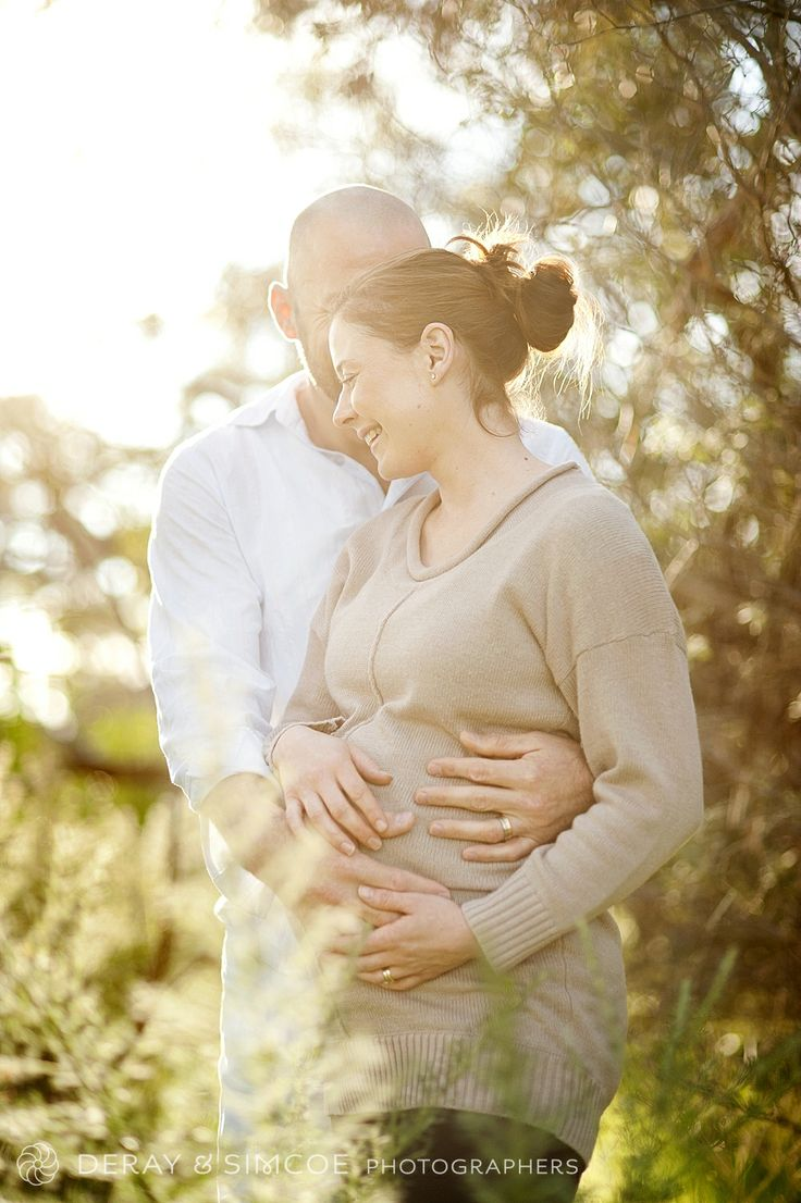 """What to wear to a maternity portrait? For pregnancy portraits figure hugging clothes are key to show off your """"bump"""". neutral tones blend with the warm rays of the sunrise. Photography by DeRay & Simcoe"""