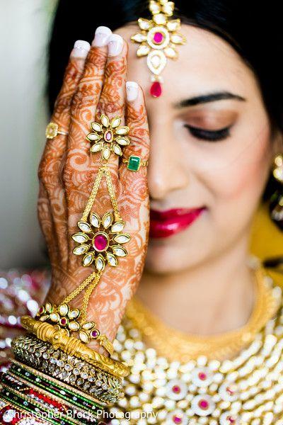 Indian bride wearing bridal lehenga and jewelry. #IndianBridalHairstyle #IndianBridalMakeup #IndianBridalFashion #BridalPhotoShoot #HaathPhool
