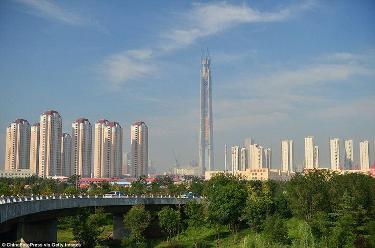 China 117 Tower (pictured centre), also known as Goldin Finance 117, has been capped at 1,957 feet high early on September 8
