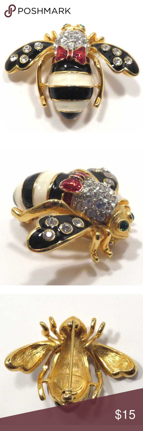 "Joan Rivers Bumblebee Pin - Striped Enamel Body Joan Rivers bumblebee pin with a striped enamel body, clear rhinestones on black enamel wings, pave rhinestone head, green rhinestone eyes.  Sports a red bow.  Measures about 1-1/2"" x 1-1/8"".   Good condition with no damage or missing stones.  (549) Jewelry Brooches"