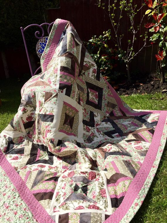I call it Earth Quilt. It's made of beautiful , earthy colours 100%cottons. Irene&Lewis, Tilda , Rose&Hubble , just to name a few.  I used half triangle pattern to make it. And framed it in beautiful green fabric with pink roses.   For the backing I used green cotton and polyester mix fabric that arrived from Morocco few years ago. I thought it's a match made in heaven , green quilt top and glossy backing. All machine quilted using straight stitch and free motion quilting.   Polyester…