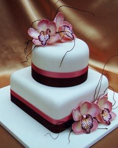 Two tier 1930's style, white, round and square wedding cake shape combo, decorated with pink and black satin ribbons and pink Cymbidium Orchids. From www.cakesofyourdreams.com.au