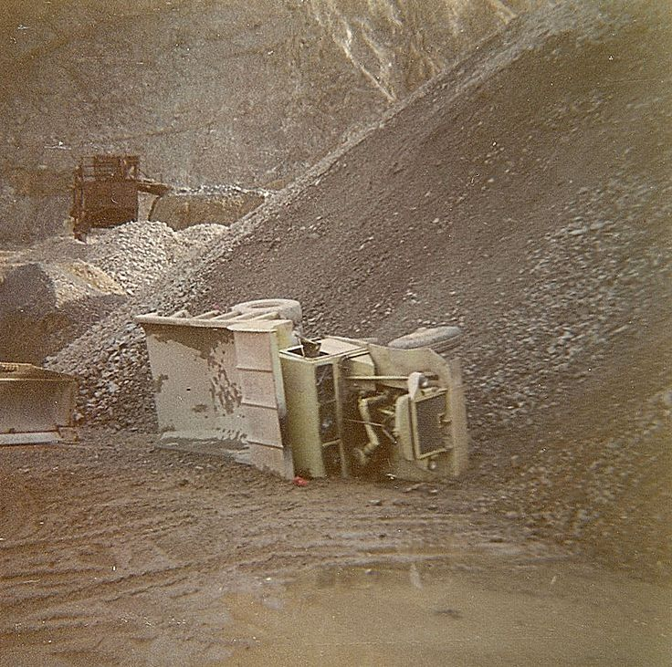 Obviously not the correct way to dump a load, this model 82FD R-15 has a wee nap at the bottom of the aggregate pile at Carsons Quarry near Plimmerton, Wellington. The machine was later repaired and put back into service.