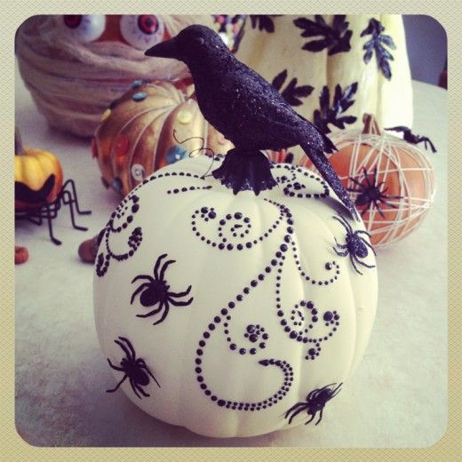 Creative Decorated Pumpkins. Love the dotted swirls but not the spiders.