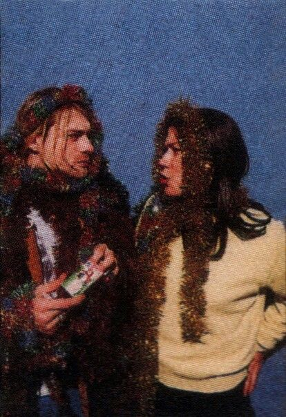 Kurt & Kim Deal from The Pixies. (: He told her to shut up during his interview hahah