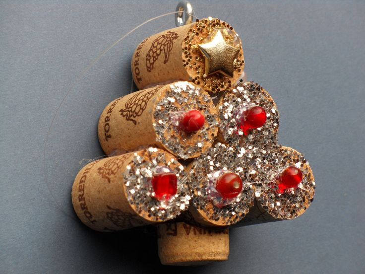 Miniature Christmas tree ornament with silver glitter, red beads, and a gold star from upcycled wine cork crafts for holiday decoration.