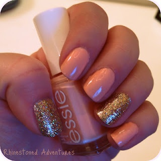 Peachy-Keen :) Essie 'A Crewed Interest' with a gold accent.
