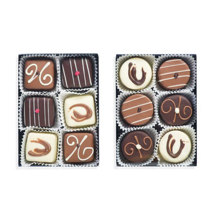 Duc d'O, un set gustoso e succulento che include due scatole di cioccolatini al marzapane.
