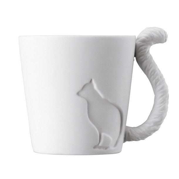 Cat Mug - adorable matte mug has a teeny cat silhouette on the outside and a feathery, detailed tail for a handle. Use it as a cute teatime accessory, or put a tiny candle in it to fill it with cozy light.
