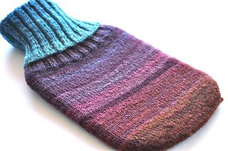 'Handspun Hottie' is a hot water bottle cover knitting pattern, designed specifically for one skein of Handspun DK to Light Worsted weight yarn (10-11wpi). However, this cover would look equally as nice in any other DK/Light Worsted weight yarn.  This cover can be knit with a short or long ribbed collar, depending on your preference and how many yards of handspun yarn you have available in your skein. It is knit from the bottom up, seamlessly, using circular knitting needles. It can also be…