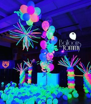 This dance floor is ready to party! The UV balloons light up the room more than the lights themselves! | Balloons by Tommy | #balloonsbytommy