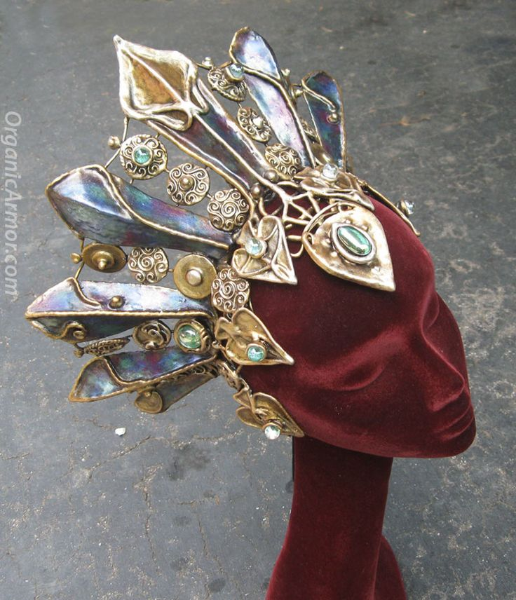 """""""I think it's a person but the face is hidden. Completely encased in a lavishly jeweled mask and headdress. My fingers slip in sweat from my brow as the statue moves. She raises a thin arm and presents a gloved hand to the people as she passes by.""""-Sammy, Ch 23, """"Tenderfoot"""" by Abby Drinen (Headdress by Organic Armor)"""