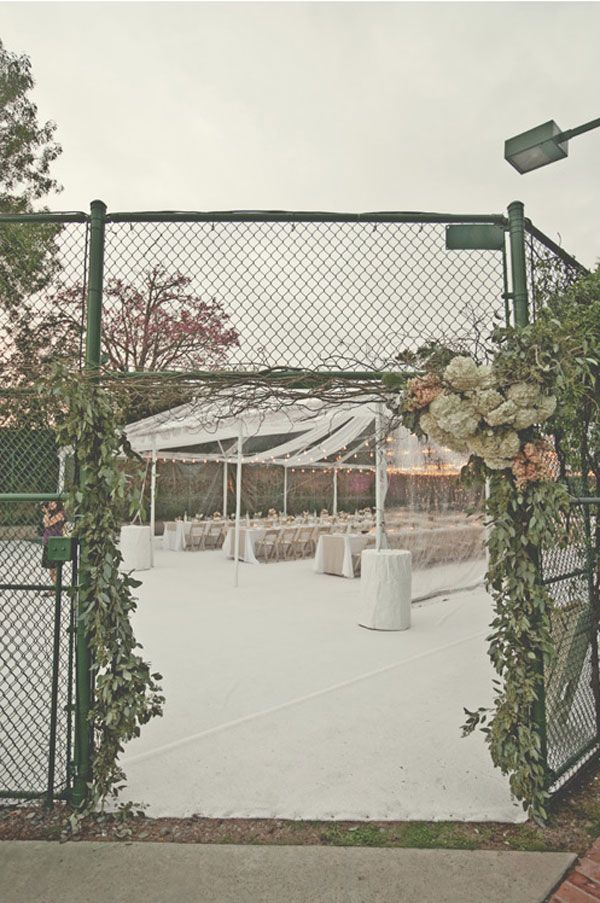 MUST SEE -- a beautiful white wedding in Autumn, using a *tennis court* for for the banquet area...I'm impressed.