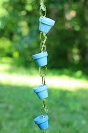 This is a simple D.I.Y. rain chain project you can make in an hour or two... just some nice copper chain, hardware, and painted mini terra cotta clay pots.