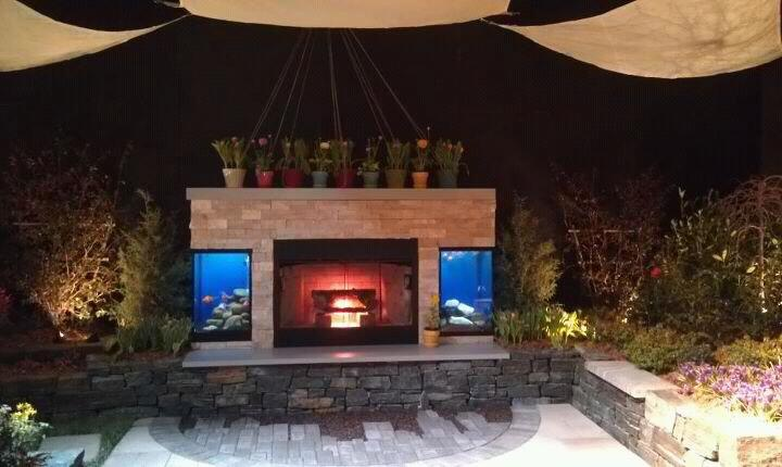 Outdoor living space fish tanks in a fireplace it can be for Fish tank fireplace