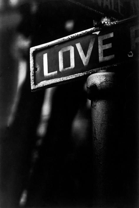 "W. Eugene Smith    USA. Pennsylvania. Pittsburgh. 1955. ""Love"", a streetsign in a poor Black district. #photography #EugeneSmith"