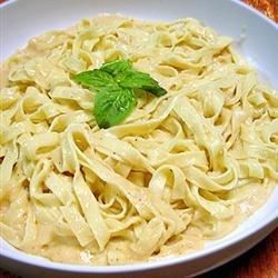 Fettuccine pasta tastes its best when served in a rich, creamy Parmesan cheese sauce made with real cream and butter.